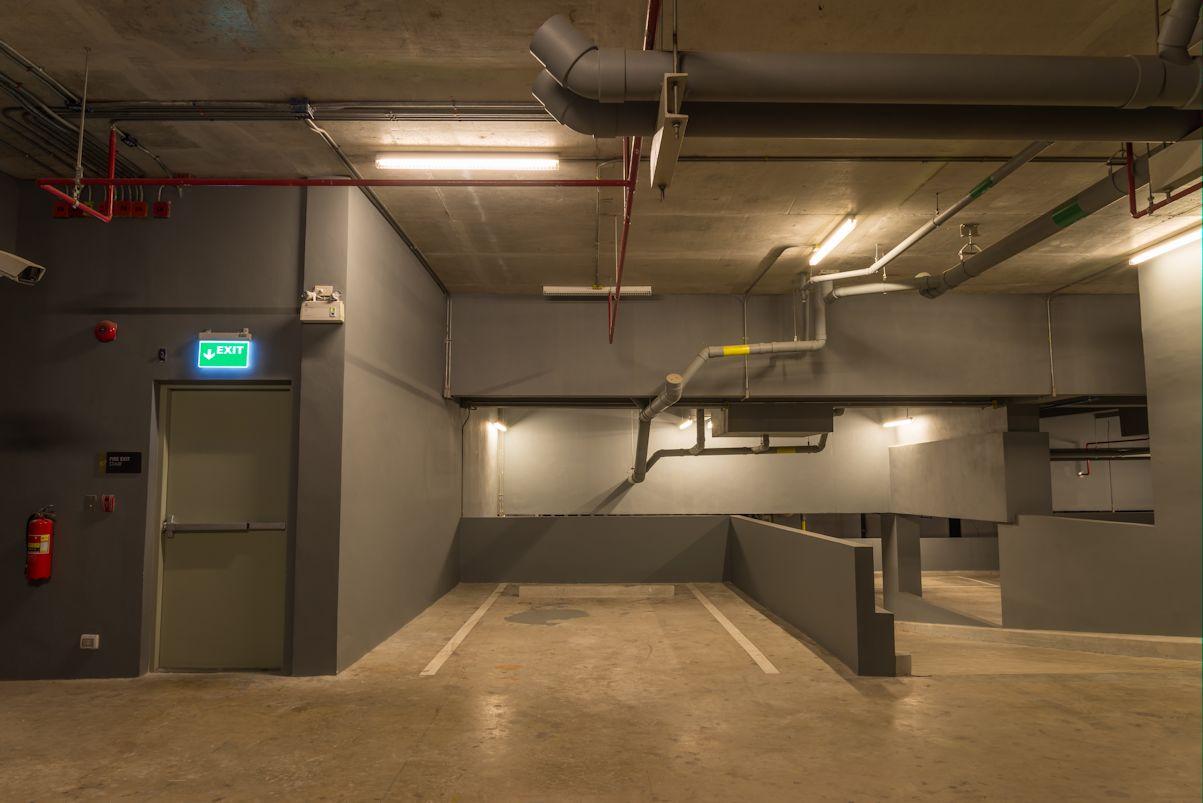 Up And Down Way In Parking Garage Interior Warm Lights In Dark